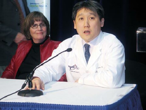 Dr. John Yee at the news Conference