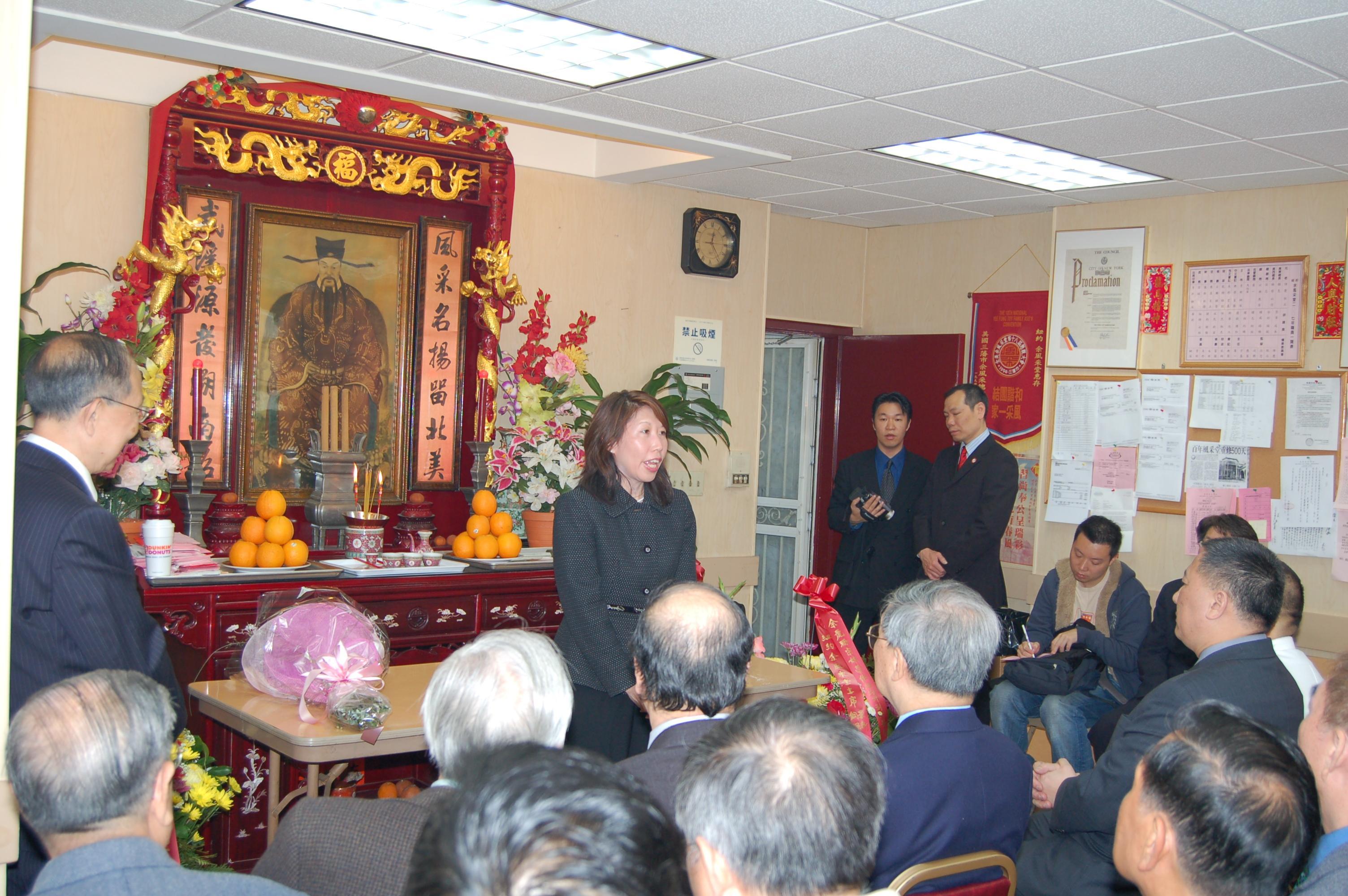 Lai Sun                         addressing guest