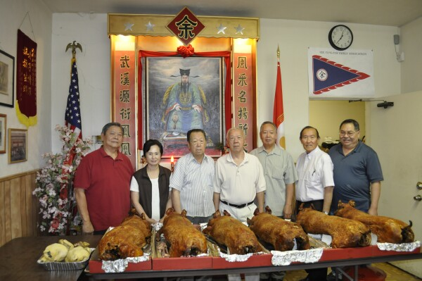 Association President                               David M Yee (far right) with 6 generous                               donors at Clan Hall YFT Anniversary 2011